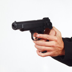 Hands with automatic handgun on a white background