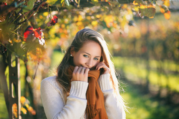 Beautiful girl in autumn colors grapevine