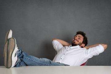 Relaxed man portrait over dark grunge background.