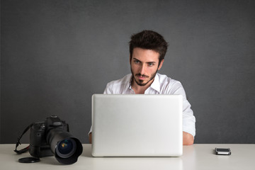 Man working with laptop portrait over dark grunge background.