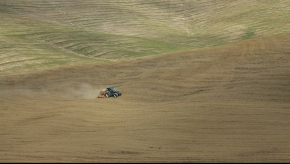 Farming with tractor in Tuscany, Italy