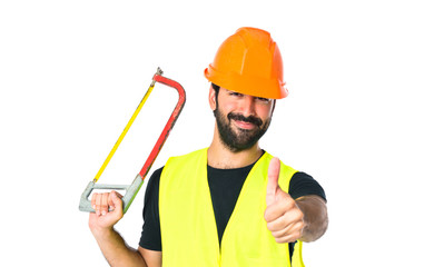 Workman with hacksaw over white background