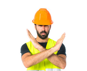 Workman making stop sign over white background