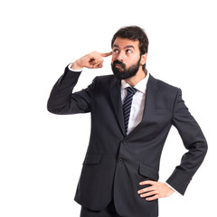 Businessman making crazy gesture over white background