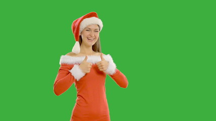 Young beautiful woman shows copy space in santa claus hat