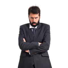Sad businessman over white background