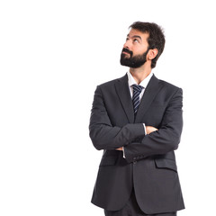 Businessman thinking over isolated white background