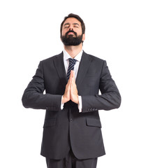 Businessman in zen position over white background