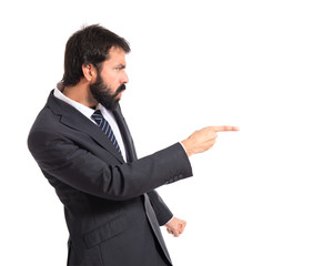 Businessman pointing and shouting over isolated white background