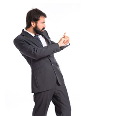 Businessman doing NO gesture over white background