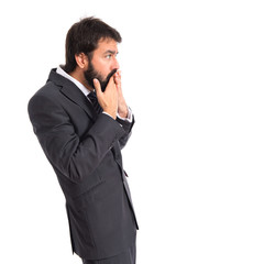 Businessman doing surprise gesture over white background