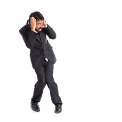 Frightened businessman over isolated white background