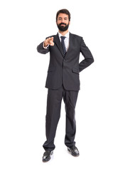 Businessman pointing to the front over white background