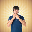 Man doing surprise gesture over pop background