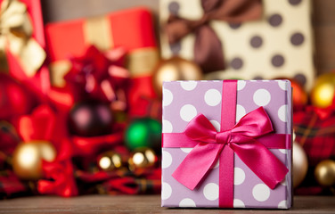 Gift box and christmas gifts on background.