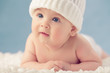 Baby in white winter hat