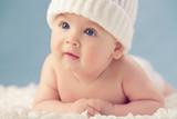 Baby in white winter hat