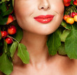 Beautiful  woman with green leaves and apples in her hair