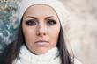 Beautiful young woman wearing white wool hat autumn portrait.