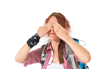 backpacker covering her eyes over isolated white background