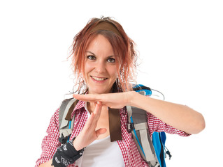 backpacker making time out gesture over white background