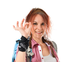 backpacker making Ok sign over white background