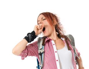 backpacker yawning over isolated white background