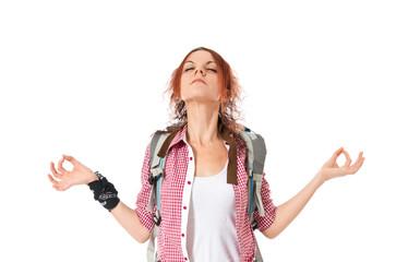 backpacker in zen position over white background