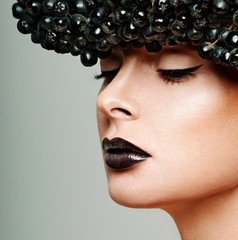 beautiful female face. professional makeup. black berries.
