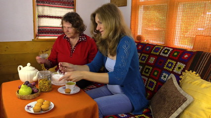 Pregnant woman drink herbal marigold tea with grandmother
