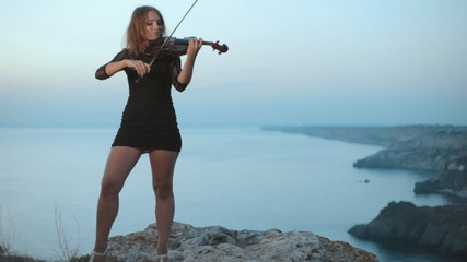 Behind  playing violinist is incredibly beautiful view on the
