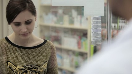 Young woman at pharmacy