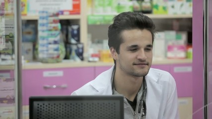 Pharmacist smiling to client