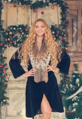 Portrait of the beautiful happy woman in furcoat