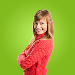 Woman with her arms crossed over green background