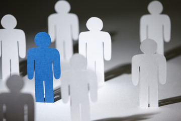 Close up of group of standing paper people