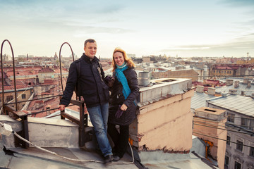 Young Caucasian couple on the roof in St.Petersburg