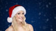 Pretty girl in Christmas cap on snowy background