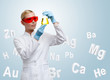 Woman doctor making chemical combination in Erlenmeyer flask