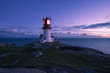 canvas print picture - Lindesnes Lighthouse in the sunset