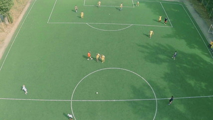Aerial shot of male team playing professional football match