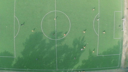 Aerial vertical view of professional football team on the field