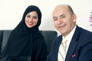Business Meeting Senior Businessman & Woman wearing Hijab