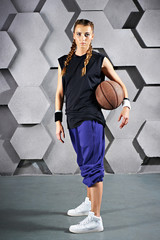 Sport girl with a basketball