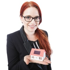 young business woman hold mini house in her hands