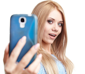 a beautiful blonde  girl taking selfie