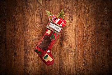 Christmas stocking hanging on a wooden wall