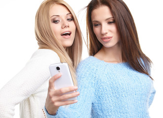 two beautiful girls making selfies at studio