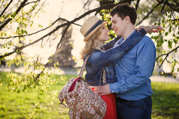 Romantic young couple embracing on steps.