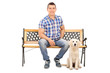 Man sitting on a bench with a cute puppy